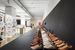 Exhibition display of rows of shoes