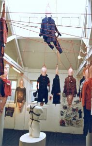 Exhibition display of dressed mannequins suspended