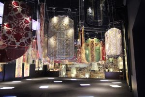 Exhibition display of tunics suspended