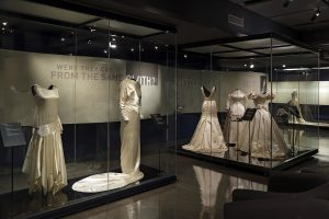 Exhibition display of dress in glass vitrine