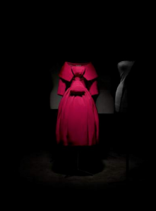 Exhibition display of red dress on mannequin