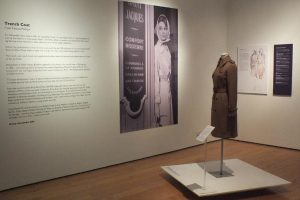 Exhibition display of dressed mannequin, text and imagery