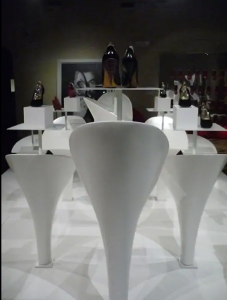 Exhibition display of white cone shapes plinths