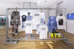 Exhibition display of clothing hanging on a wire frame